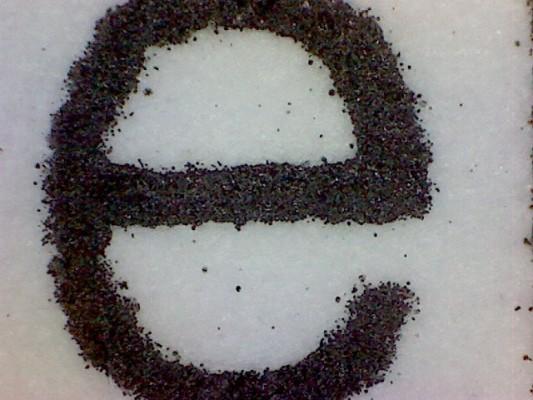 Literka e na wydruku laserowym